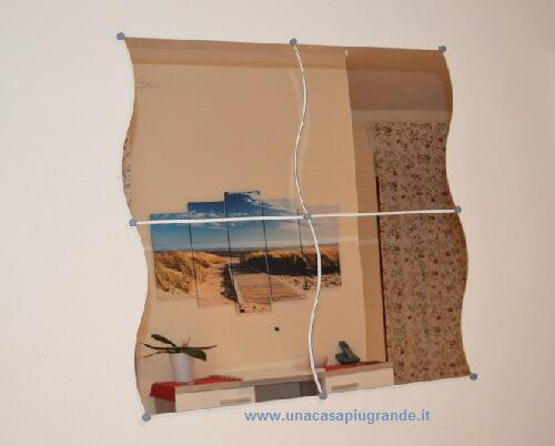 specchio Krabb montato a parete